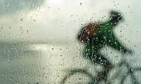 Image of cyclist though wet windshield