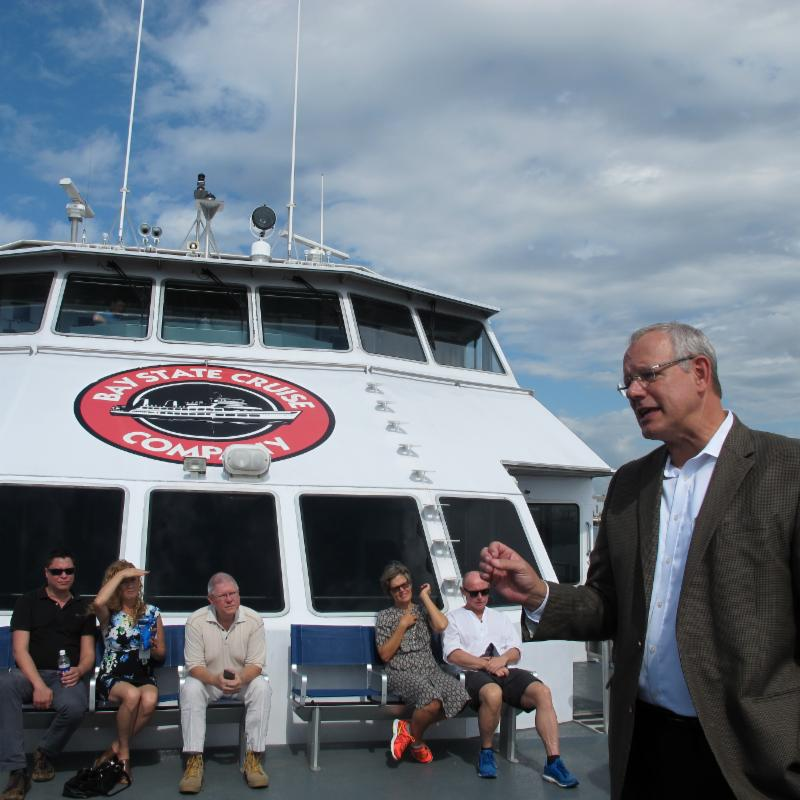 Ed Turanchik addresses riders on the Cross Bay Ferry