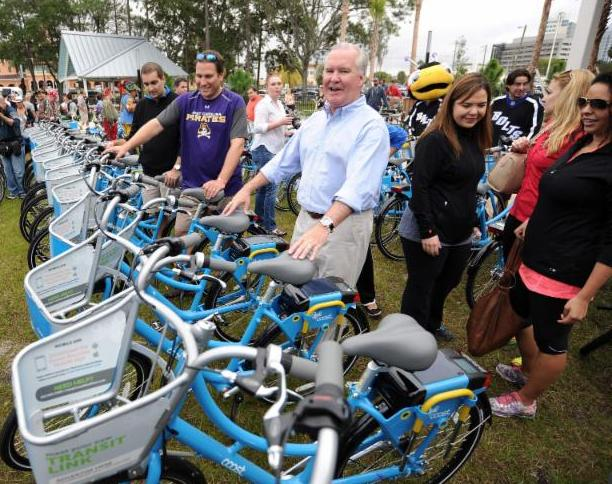 Mayor Bob Buckhorn posesd with Cost Bike Tampa