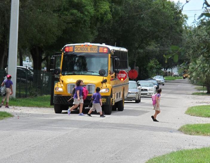 Children exit bus with no sidewalks