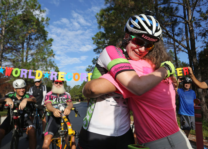 Amanda Coker breaks world record for highest annual mileage on a bicycle.