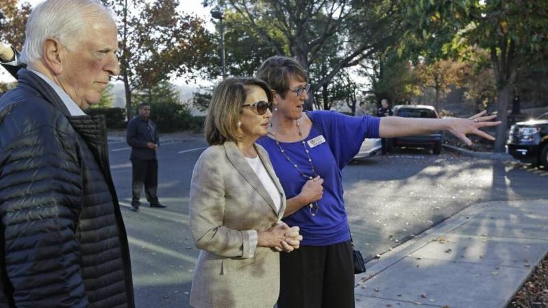 Naomi Fuchs, right, CEO of Santa Rosa Community Health, shows Reps. Nancy Pelosi and Mike Thompson how the wildfire affected its Vista campus last October. Ben Margot-AP