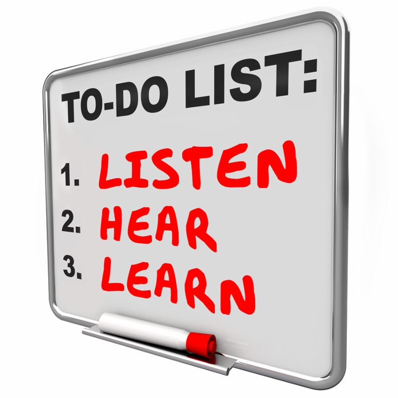 Listen, Hear and Learn words written on a dry erase board to illustrate knowledge, understanding and paying attention to others