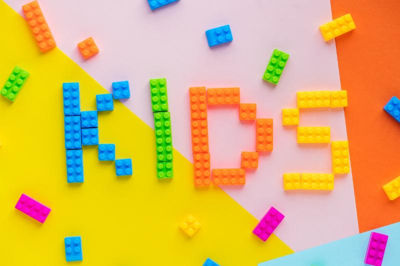 KIDS spelled in colorful letters