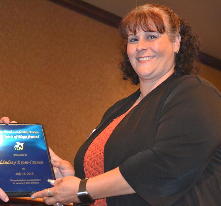Lindsey Krom Craven holding her award
