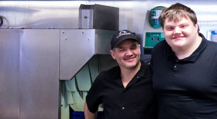Two male employees from Algonquin Resort smiling.