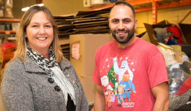 Female supervisor with male RWA employee at Value Village.