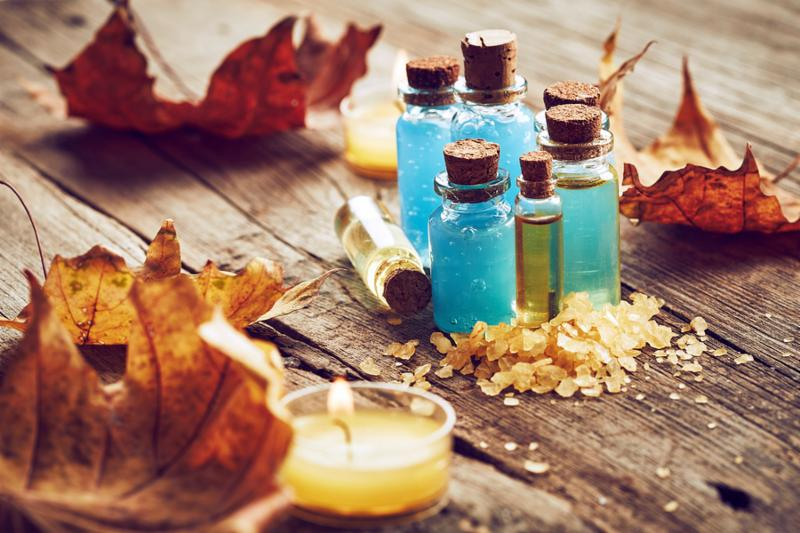 Spa still life with autumn leaves on wooden background