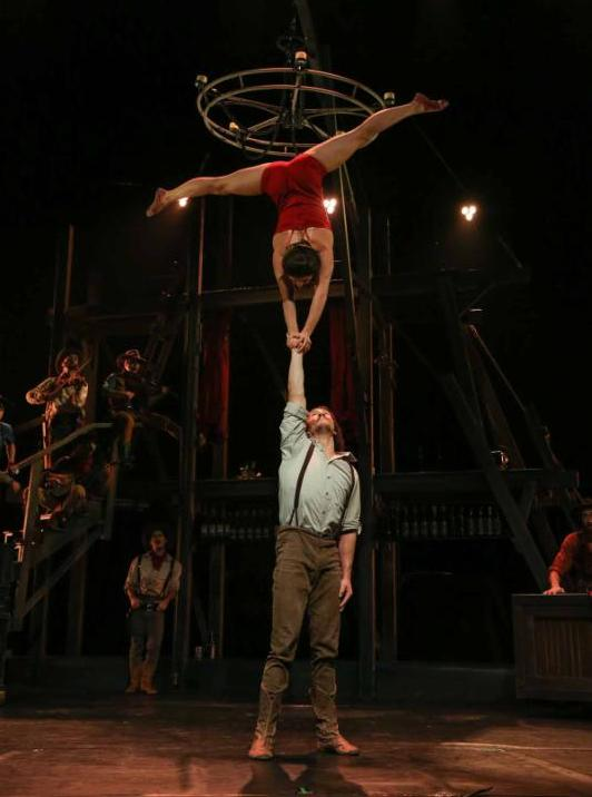 acrobats in saloon attire