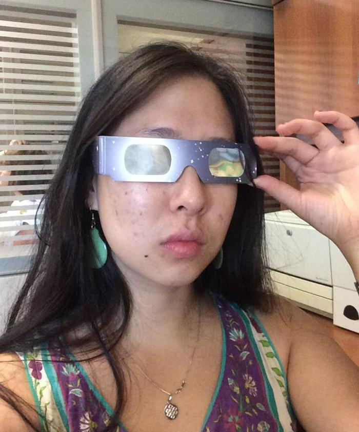 woman wearing eclipse glasses
