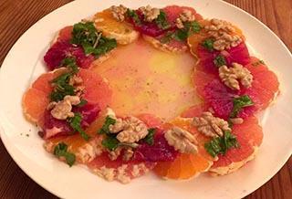 platter of sliced fruit