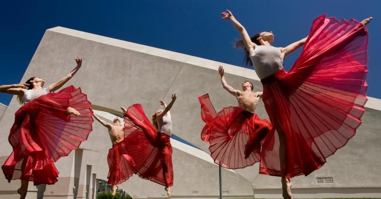 dancers with swirling red skirts