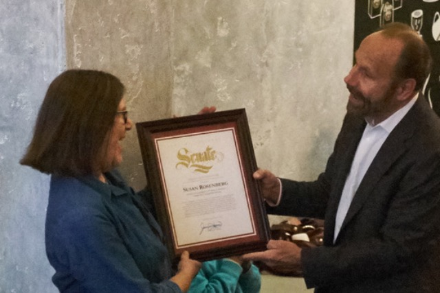 Susan Rosenberg accepts award from Jerry Hill