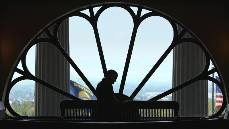 John S Adams silhouetted in the Montana Capitol building_ from DARK MONEY a PBS Distribution release