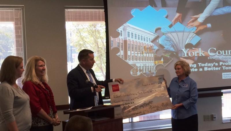 Wells Fargo presents _20_000 check