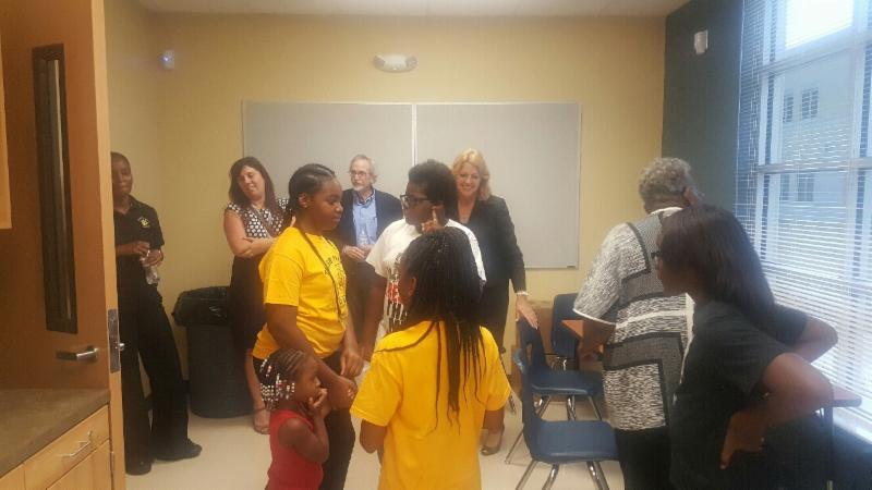 Mrs gordon with tangelo park administrators staff and students during the sneak peek for Millennia gardens elementary school