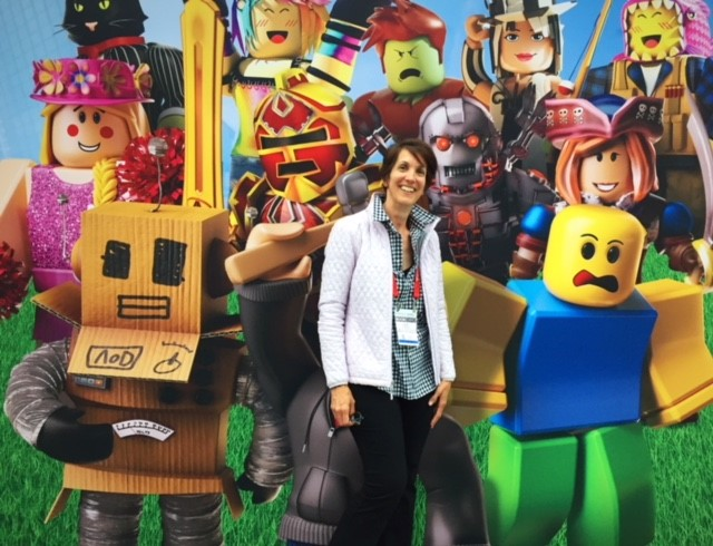 Julie with LEGO backdrop at Book Expo