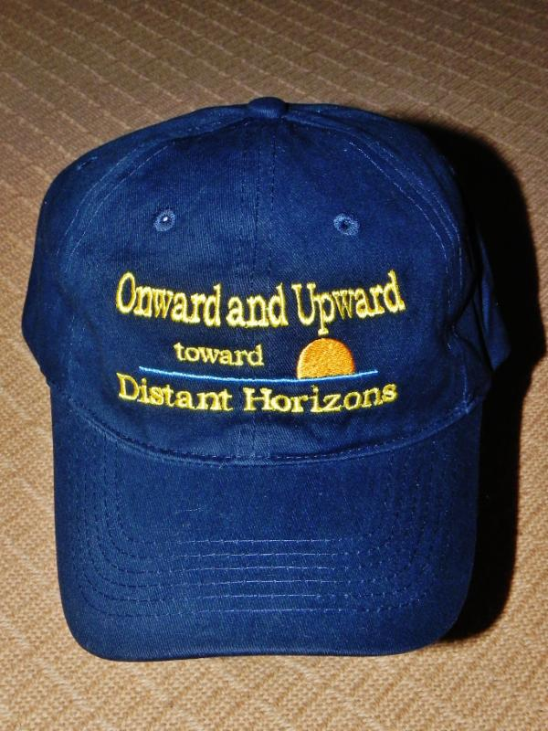 Hat showing Onward and Upward toward Distant Horizons, the author's motto