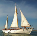 Macomber Tours on sailing ketch, Alondra, docked at Tarpon Lodge on Pine Island, FL