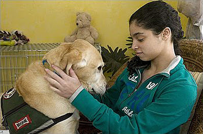 Girl petting service dog