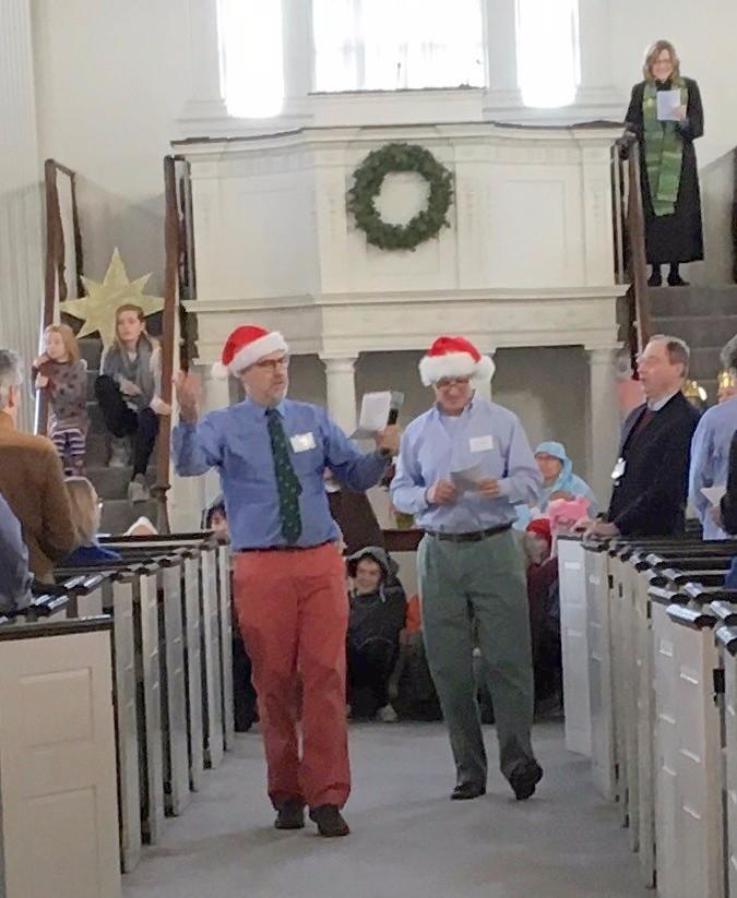 Two men in Santa caps
