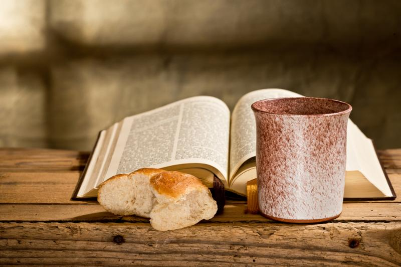 still life with Bible chalice and bread Note Shallow depth of field