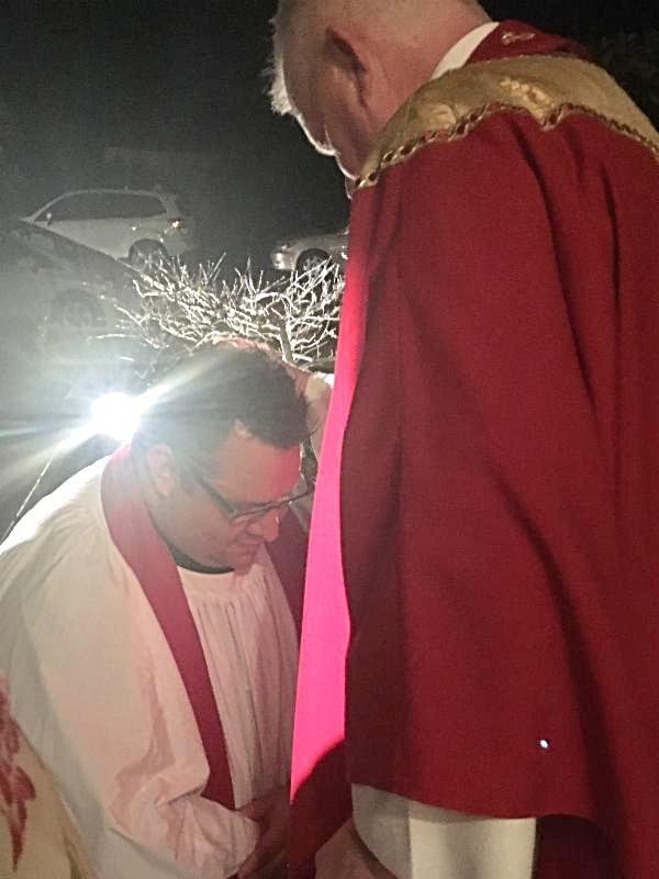 The new Rev. Rickert blesses Father Kenn Katona