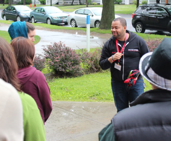 Elijah leading students on a campus tour at UYP