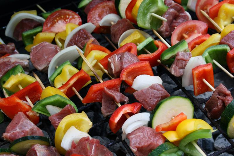 Delicious Shish-k-bobs grilling on a charcoal grill     Note  Shallow depth of field