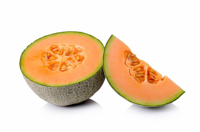 Fresh cantaloupe melon isolated on white background