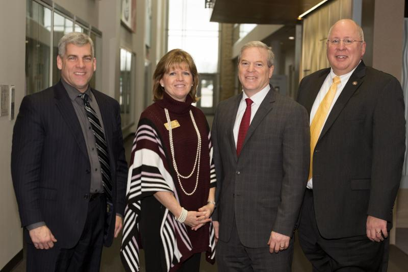 Photo: Judy Mitchell with Joliet Junior College, David Livingston with Lewis University and Arvid Johnson with the University of St. Francis and Mayor of Joliet Bob O'Dekirk.
