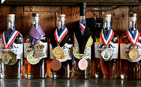 Up North Distillery spirits with medals