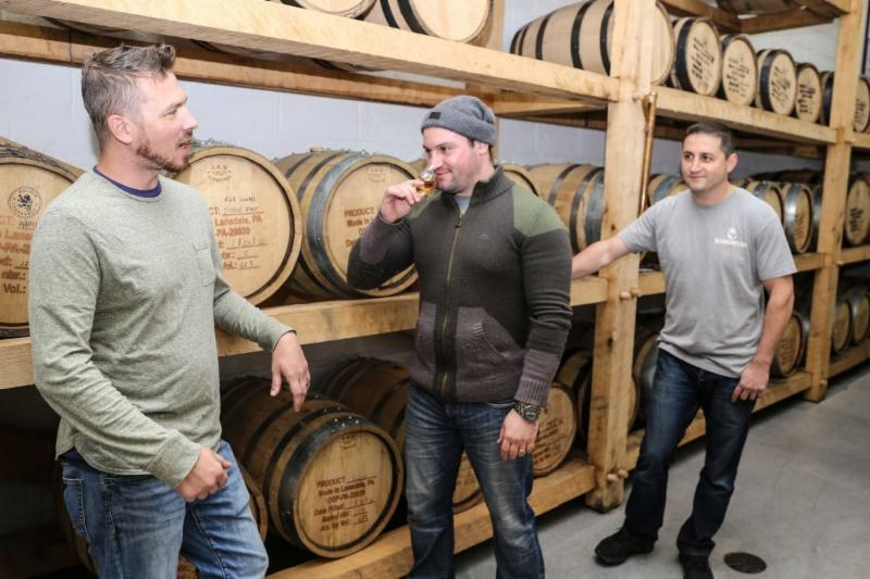 Distiller Tim Mokes _left__ with owners Marat and Vlad Mamedov_ at Boardroom Spirits.