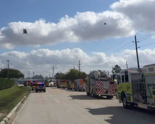 A rescue helicopter and multiple fire engines respond to an explosion at distillery in Houston_ TX