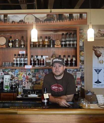 Josh Mayr behind the bar of his Wishkah River Distillery tasting room