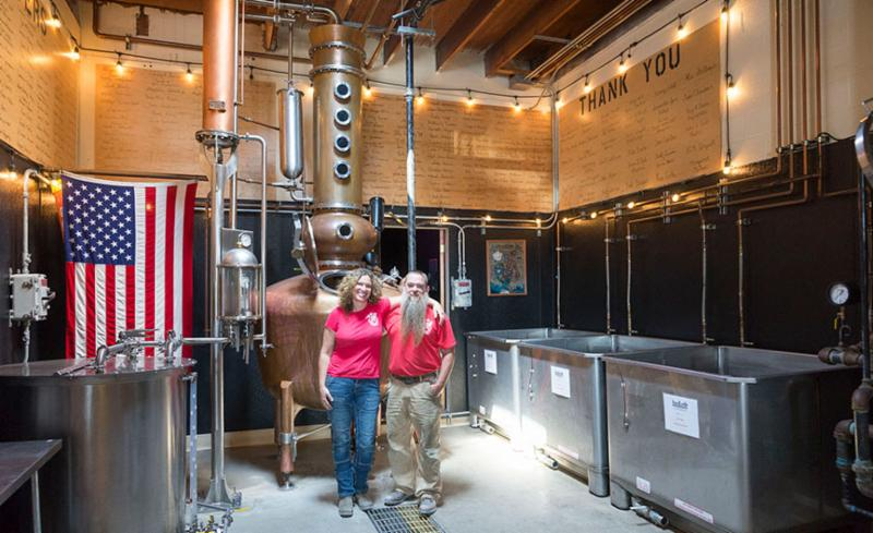 Above_ husband and wife team Amy and Steve Bohner_ owners of Alchemy Distillery_