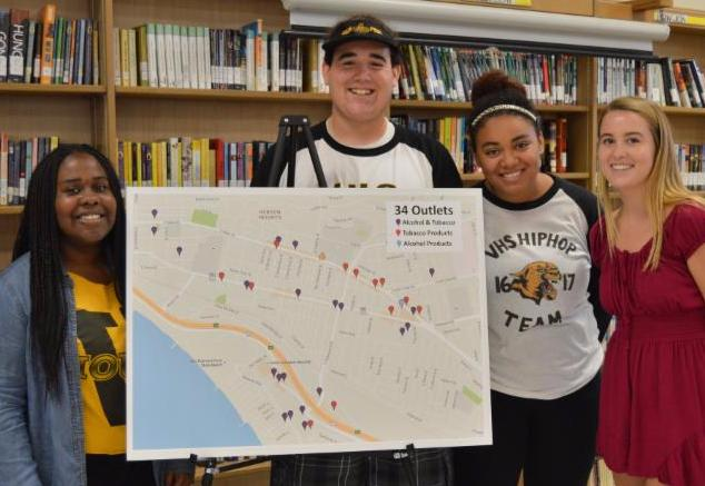 Friday Night Live students with their map showing stores that sell alcohol and tobacco near schools