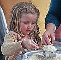 Girl Measuring Flour