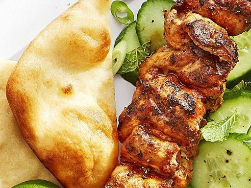 Spiced chicken skewers with cucumber salad