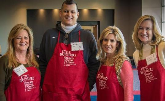 Thanksgiving volunteers with red aprons