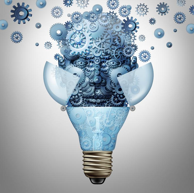 Artificial intelligence ideas as a robot head symbol made of gears and cog wheels emerges out of an open light bulb or lightbulb as an icon of highly advanced creative computing technology.