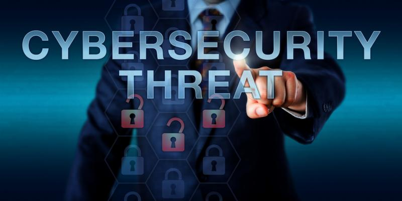 Enterprise user is pushing CYBERSECURITY THREAT on a touch screen interface. Information security concept for a vulnerability software flaw or system susceptibility exposed to a cyber attack.