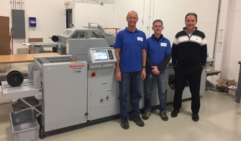 Shown above are the Horizon Stitchliner 5500 System and Hof 400 Variable Data High Speed Booklet-making Systems with operators _L to R_ Warren Bryant_ Dane Edgley and Steve Klaric from KBR Graphics.
