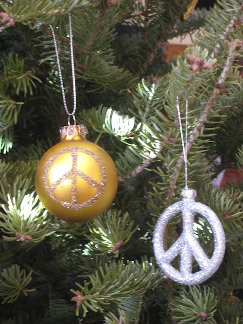 Holiday peace ornaments on tree