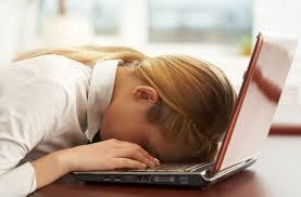student asleep on laptop