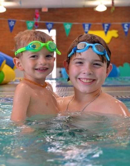 Vertical Smiling Swimmer Boys