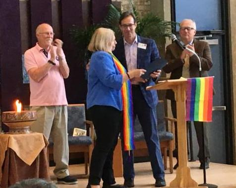 Rev Linda receiving proclamation