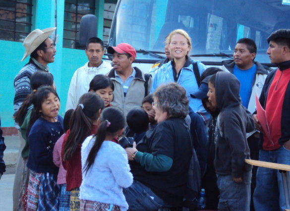Accompanier surrounded by Guatemalan youth