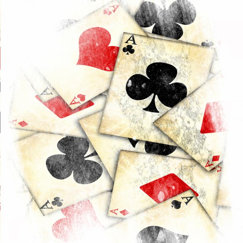 grunge playing card on a soft brown background