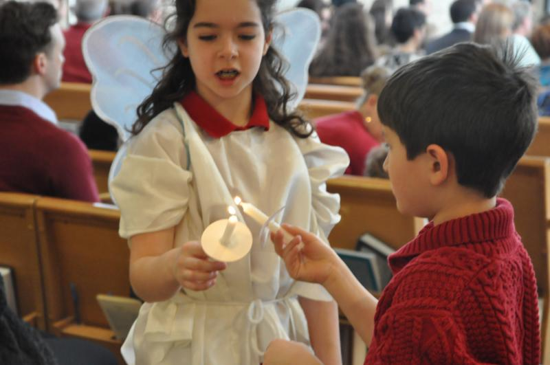Kids lighting candle